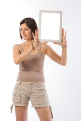 Beutiful girl holding a white blank frame
