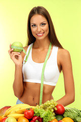 beautiful young woman with fruits and vegetables,