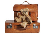 Well-Traveled Vintage Suitcase and Teddy Bear
