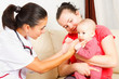 Pediatrician checking a baby