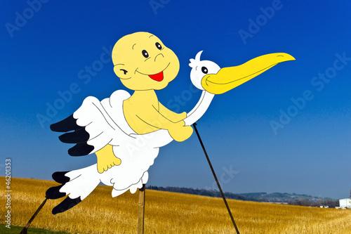 Storch bei Neugeborenem