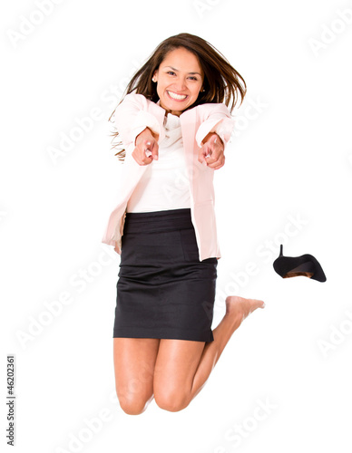 Happy businesswoman jumping