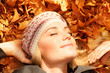 Cute girl dreaming on autumn leaves