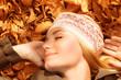 Pretty woman sleeping on fall foliage