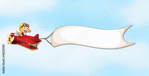 an air plane, a boy and a banner