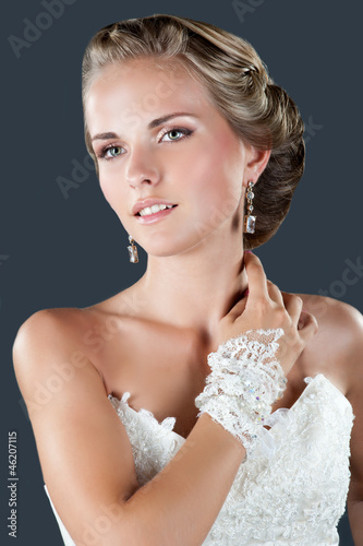 Happy sexy beautiful bride blond girl in white wedding dress wit