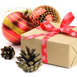 Christmas gift with pine cones and red baubles