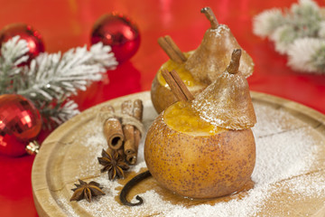 Christmas food baked pears with jam and baubles