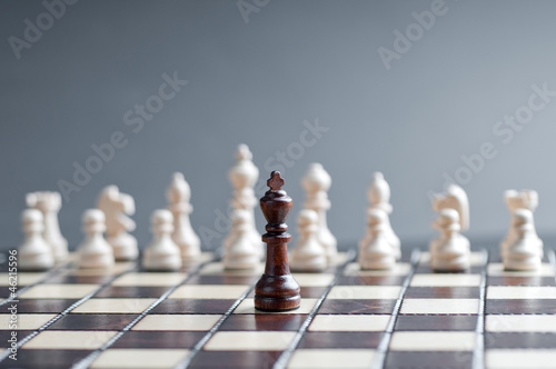 concept of wooden chess. one black chess against white