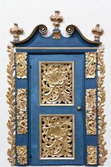 Golden door. Interior of baroque church in Poland