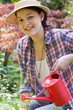 Junge Frau mit Giesskanne, young woman with watering can