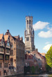 Classic view of channels of Bruges..Tower Belfort in Bruges