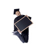 graduated teenage guy jumping while holding blackboard