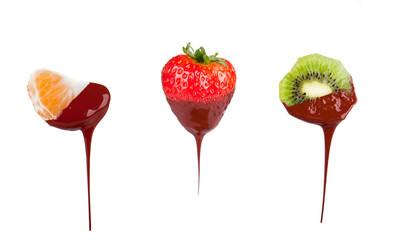 Strawberry, mandarin and kiwi dipped in melting dark chocolate  © verca