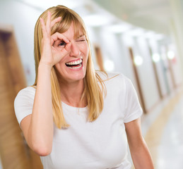 Happy Woman Looking Through Finger