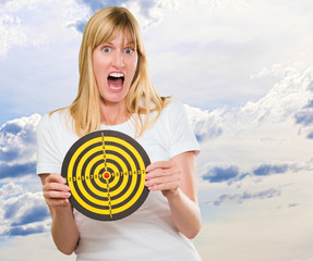Afraid Woman Holding Dartboard