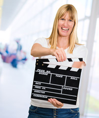 Happy Woman Holding Clapper Board