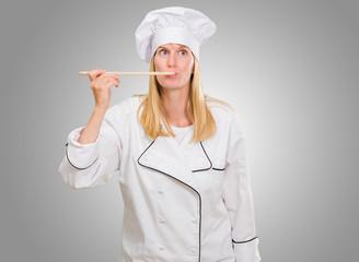 Female Chef Tasting Food