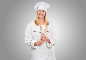 Female Chef Holding Wooden Spoon
