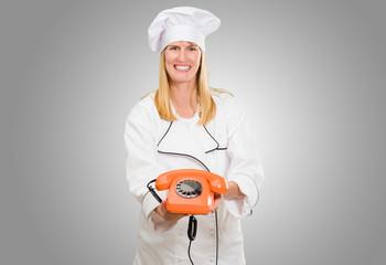 Female Chef Holding Telephone