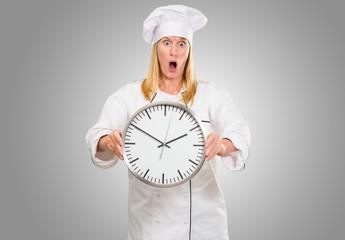 Shocked Female Chef Holding Clock