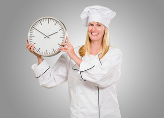 Female Chef Holding Clock