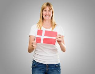 woman holding a denmark flag