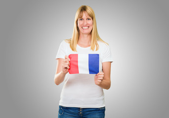 woman holding a french flag
