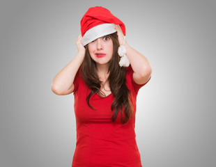 worried woman wearing a christmas hat