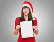 worried christmas woman holding a blank card