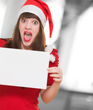 surprised christmas woman holding a blank card