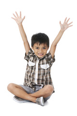 happy boy with raised arms on white background