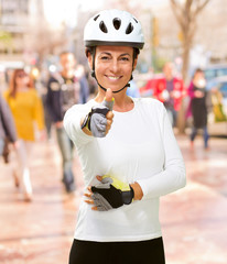 Woman Wearing Helmet Showing Thumb Up
