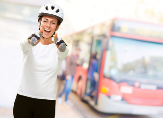 Woman Wearing Helmet Showing Both Thumbs Up
