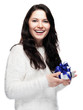 Sweet beautiful young woman is pleased with a gift