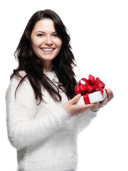 Sweet young woman is pleased with a gift