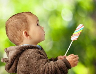 Portrait Of A Baby Holding Lollipop