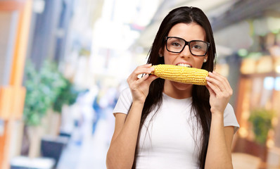 Young Girl Eating Corn