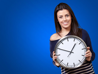 Young Girl Showing Clock