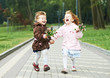 two little laughing kids girls outdoors