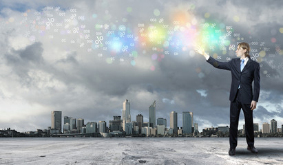 Businessman with colourful light beam in his hands