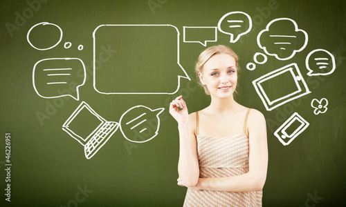 portrait of young teacher near blackboard
