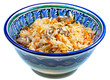 traditional asian pilau with meat in ceramic bowl