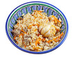 traditional asian pilaf with garlic bulb in ceramic bowl