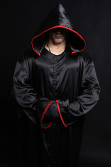 Young man in a monks robe