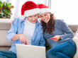 Christmas Online Shopping. Couple Using Credit Card to E-Shop