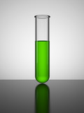 Beaker with green liquid. Test tube.