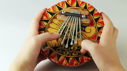 person plays a musical instrument kalimba