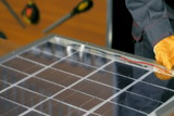 Man building DIY solar panel poster