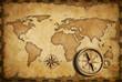 Leinwandbild Motiv aged brass antique nautical pocket compass with old map